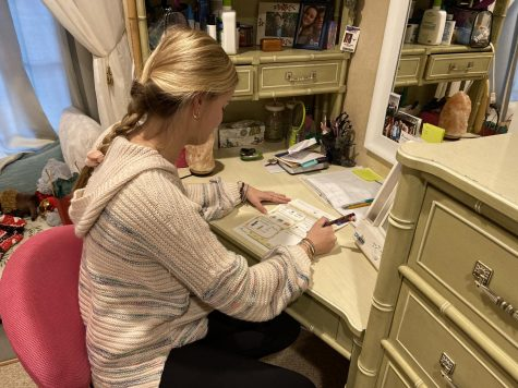 """Senior Kelsey Long writes her monthly letter that she sends to the child, Briani,  she sponsors in Honduras. Long was excited to be able to tell Briani about her life and update her on what happened over the course of the month. """"I am very grateful for the opportunity to hear about a different culture firsthand,"""" Long said."""