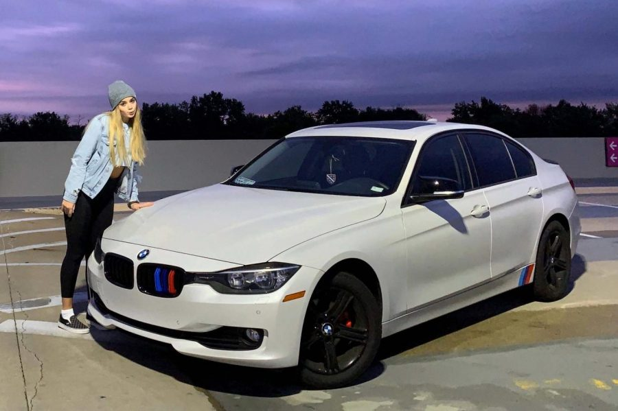 """Senior Amal Mustic poses in front of her F30 BMW, a car she has remodeled to fit her liking. Mustic, learning how to fix the interior or exterior of her car, believes it is a way for her to express herself. """"The idea of being able to make it [my car] my own just fascinated me,"""" Mustic said. """"That's my car, it's separate from others."""""""