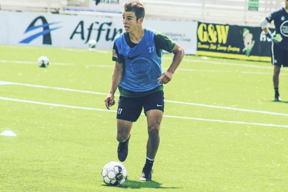 """Senior Jansen Miller dribbles the ball up the field during practice with St. Louis Football Club  (STLFC). Miller recently made his commitment to Xavier University. """"It was the family culture there,"""" Miller said. """"Most schools, you'll hear them say 'oh we have a family culture' but you could really feel it with Xavier."""""""