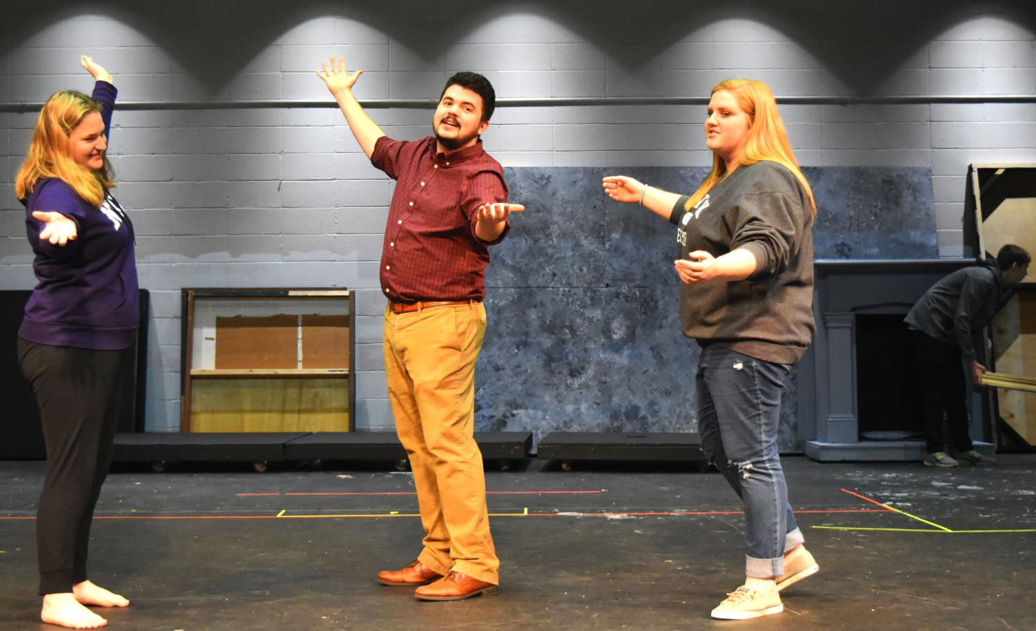 Seniors Abigayle Dorrance, Sophie Reidt and choreographer Joe Milliano rehearse a tap routine to go along with the song