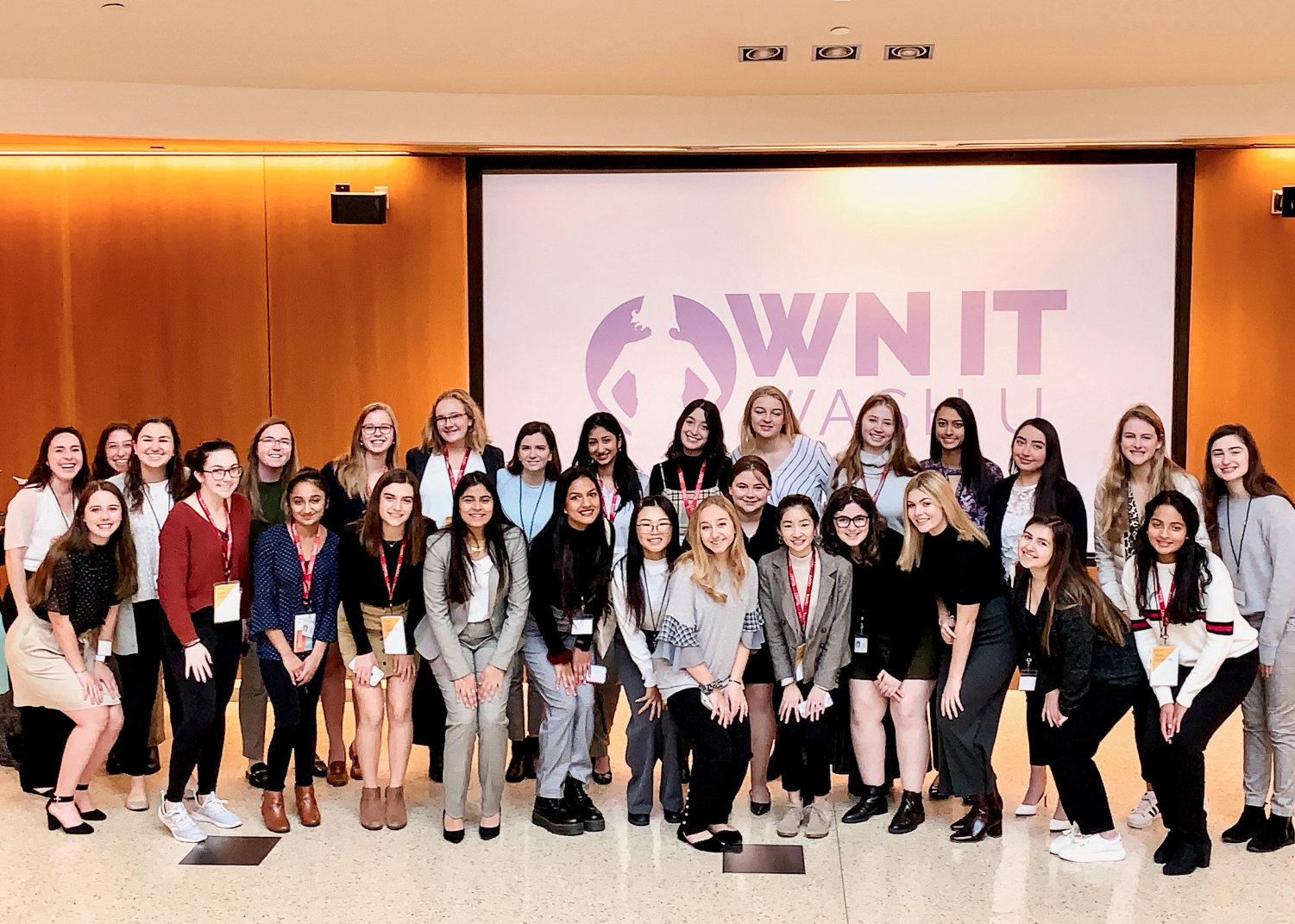 """Marks and Crawford pose for a group photo along with other students that attended the Olin Future Women In Business weekend. Before attending, Crawford planned to go into the medical field, but now feels suited for a business career. """"I wasn't sure if I wanted to go into business. It [the event] opened my eyes, and this is something I'm really interested in now,"""" Crawford said."""