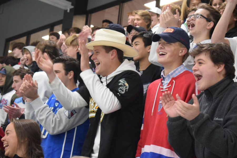 "Seniors Tommy Mohan, Tyler Purdum, Garrett Larsen and Patrick Hill cheer on the hockey team. The team took the win against Parkway South 8-2 at Maryville Hockey Center. ""I like the energy of hockey games, it's loud and fun, especially when we beat our rivals,"" Mohan said."