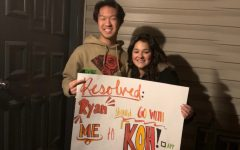 Freshmen Ryan Feng and Hope Green smile with the KOH poster Green made.
