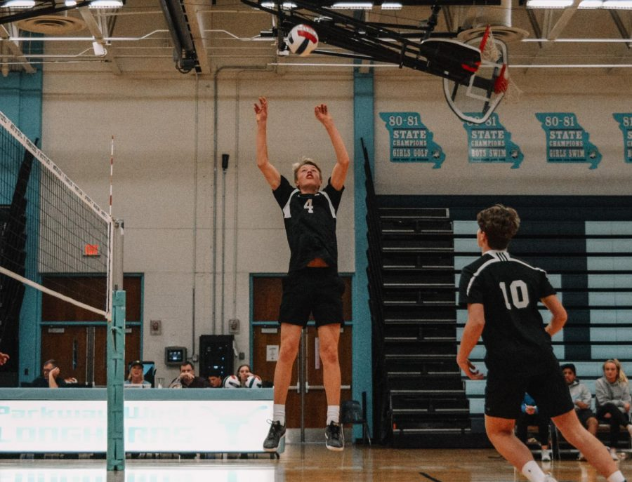 Jumping+to+set+a+ball%2C+sophomore+Ethan+Jennings+assists+an+attack+for+junior+Evan+Conger.+Jennings+played+JV+volleyball+his+freshman+year+and+continues+to+play+for+the+High+Performance+Volleyball+program.+%E2%80%9CPlaying+with+older+guys+was+great+because+it+gave+me+a+unique+experience+that+most+guys+my+age+don%E2%80%99t+usually+have+and+pushed+me+to+work+harder%2C%E2%80%9D+Jennings+said.