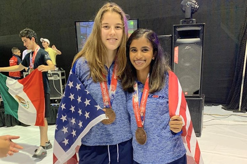 Wrapped+in+the+American+flag%2C+senior+Erin+Slutzky+and+doubles+partner%2C+freshman+at+University+of+California%2C+Berkeley%2C+Nikita+Chauhan+celebrate+their+performance+at+the+International+Racquetball+Championships+%28Worlds%29.+Though+this+was+Slutzky%E2%80%99s+second+Worlds+debut%2C+she+won+a+medal+for+the+first+time.+%E2%80%9CThe+best+thing+about+getting+bronze+was+the+improvement+it+showed+from+the+year+before+at+Worlds+in+Mexico+where+I+didn%E2%80%99t+get+a+medal.+It+meant+my+hours+and+hours+of+training+had+paid+off%2C%E2%80%9D+Slutzky+said.+
