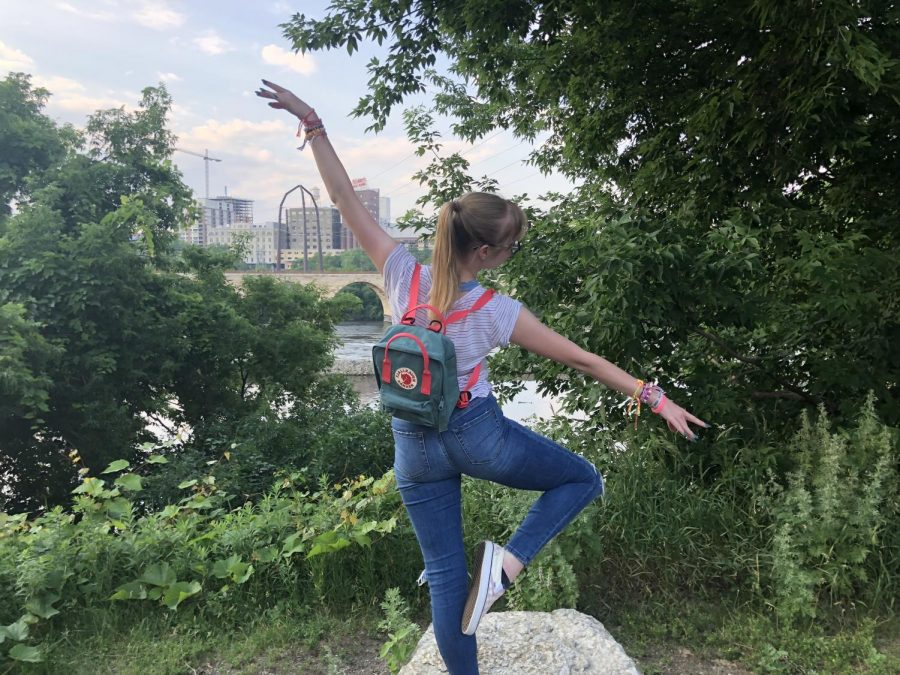 "Hitting a posse, senior Maggie Lyerla balances on a rock in front of a river in St. Paul, MN. Lyerla explored St. Paul, Minn. while she was recovering at The Emily Program in July. ""It was cool to travel somewhere I've never been, even though it wasn't necessarily a vacation,"" Lyerla said."