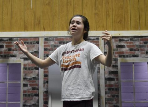 "Portraying the character Janet Van De Graaff, junior Arden Dickson rehearses a scene from ""The Drowsy Chaperone."""