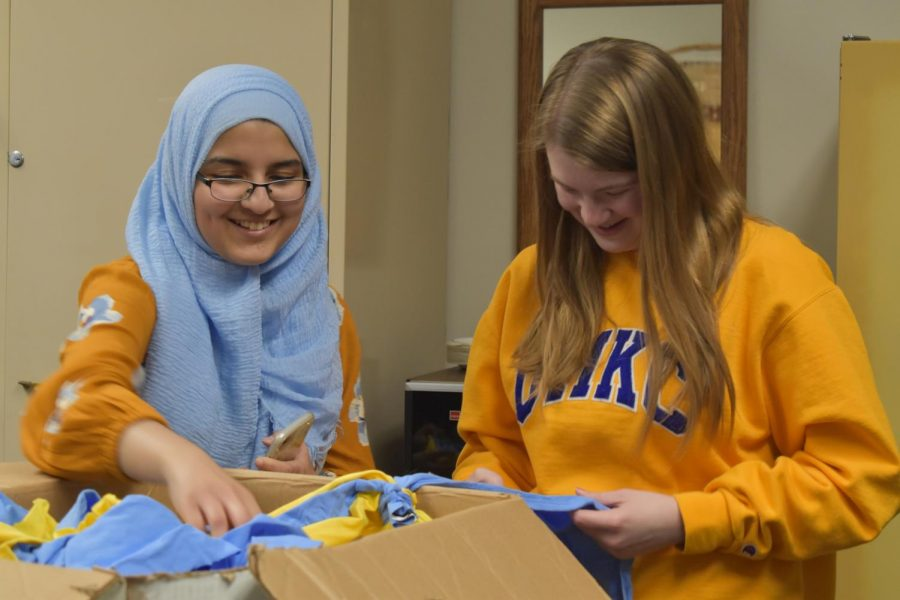 Cutting+out+strips+of+fabric+for+a+Day+of+Service+freshmen+project%2C+junior+and+club-founder+Fatima+Shahab+and+junior+Brooke+Gangel+construct+dog+toys+to+be+donated+to+the+Humane+Society.+Crafting+for+a+Cause+meets+once+a+month+to+focus+on+a+new+project+and+create+hand-made+items+to+donate+to+different+organizations.+%E2%80%9CThe+goal+is+to+make+something+or+have+some+sort+of+project+to+donate+or+help+someone+in+some+way%2C%E2%80%9D+Shahab+said.+%E2%80%9CI+decided+to+start+Crafting+for+a+Cause+because+I+really+like+crafting+and+sewing.+I+wanted+to+combine+my+hobby+with+helping+others+and+I+thought+this+was+a+good+way+to+do+that.%E2%80%9D