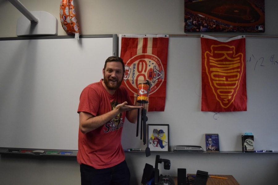English teacher Casey Holland drinks coffee out of his red Chiefs cup as a superstition.