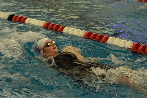 "With an effort to finish, senior Lydia Roseman swims 100 yard backstroke at the end of the Yellow Pool Conference Finals. Between the preliminary swim Tuesday, Feb. 4 and finals Thursday, Feb. 6, Roseman dropped a combined 3.44 seconds in this event. ""It was just a really great way for me to finish off my season because I accomplished way more than I thought I would. I was hoping for just a small time drop, but then I ended up dropping a significant amount,"" Roseman said."
