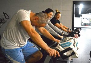 Spinning at school: Teachers jam out to hits as they get a workout in