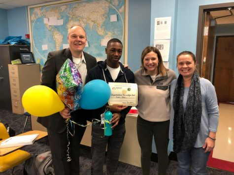 "Principal Jeremy Mitchell, freshman Jordan Allen, Language Coordinator Amy Belding and Spanish teacher Dominique Navarro pose for a photo to congratulate Allen on winning a travel scholarship to the Galapagos Islands from Just Overseas. Allen, Mitchell, Belding and Navarro presented the scholarship to Allen while he was in Modern United States History class. ""I was extremely surprised and thankful when I was presented with the scholarship because it had been a while since I had applied and I knew that other people applied as well,"" Allen said."