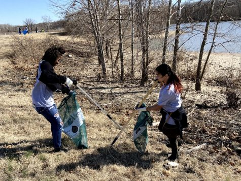 "Picking up trash along a stream, sophomores Daniellie McLaurin and Natalie Huff participate in the annual Day of Service by supporting The Stream Cleaning Organization of St. Louis March 5. Students had the opportunity to go out in their communities and volunteer with their common ground classes. ""It was such a great opportunity to go out and be able to serve the community. The best part was when we were all picking up trash; it was kind of like a competition,"" Huff said. ""It was a lot of fun, and I liked that we were able to do a lot of walking and [were able] to enjoy the outdoors."""