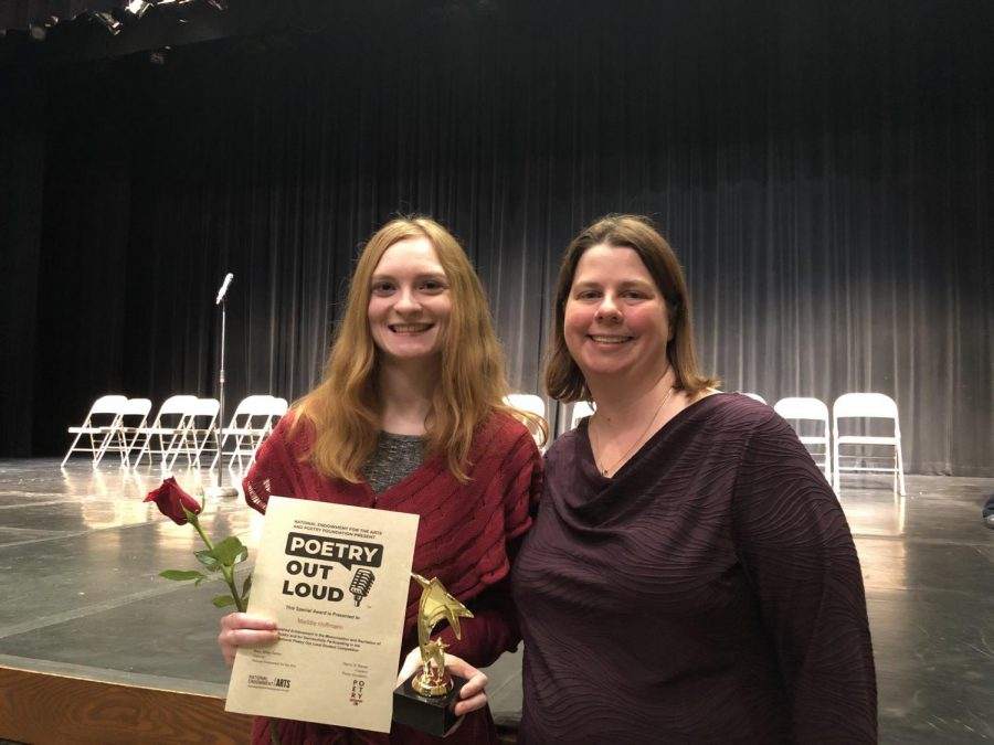 Senior+Maddie+Hoffmann+celebrates+her+success+at+the+2020+Poetry+Out+Loud+regional+competition+with+English+teacher+Andrea+Benmuvhar.+Hoffmann+received+a+certificate+and+a+trophy+as+well+as+a+flower+for+her+achievement.+%E2%80%9CI+never+thought+that+I%E2%80%99d+go+up+on+stage+and+force+myself+%5Bto+perform%5D%2C+but+I+think+I+took+my+confidence+a+step+further.+I%E2%80%99m+very+proud+of+what+I%E2%80%99m+now+capable+of+doing.+I%E2%80%99m+glad+that+I+overcame+my+stage+fright+as+well+as+testing+out+my+knowledge+on+poetry%2C%E2%80%9D+Hoffmann+said.