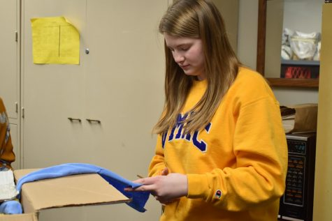 "Cutting out strips of fabric for a Day of Service project, junior Brooke Gangel makes dog toys to donate to the Humane Society. Crafting for a Cause Club meets every month to choose a project that will benefit their community. ""I 100%  support Crafting for a Cause,"" Gangel said. ""It"