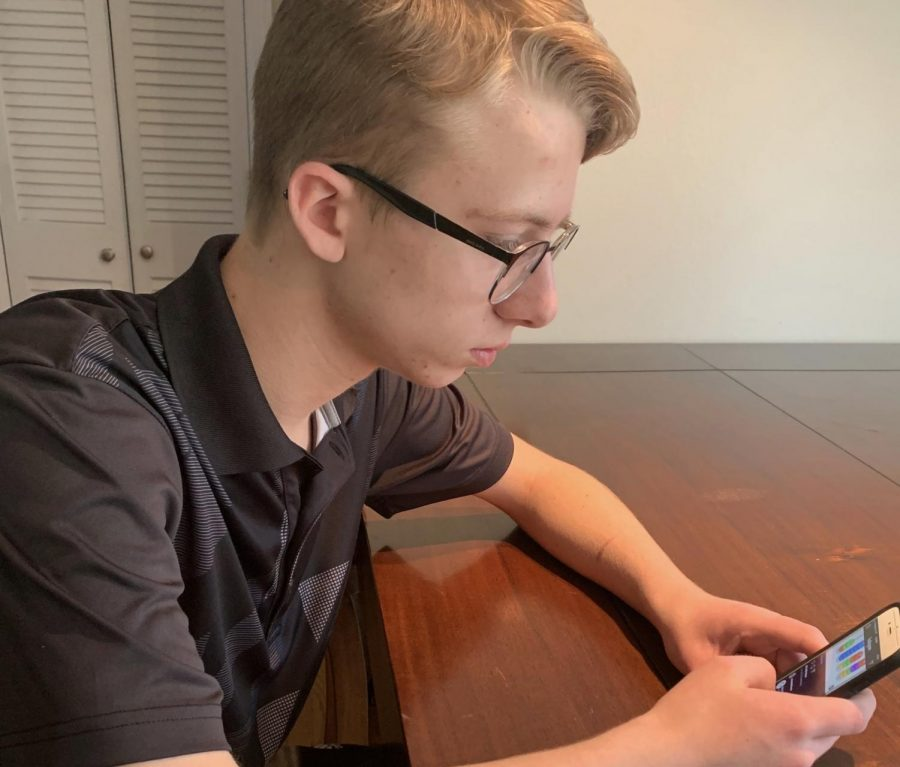 Quarantined at home, junior Drew Milholland scrolls through Instagram for inspiration and entertainment. Social media is what many students have used to distract themselves from boredom.