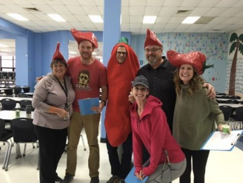 Dr. Corey Sink poses with Building Manager Kitty Strong, English teacher Cassey Holland, former Building Manager Scott Bollman, Librarian Lauren Reusch and FACS teacher Katie Hashley. Sink and the faculty members judge West's annual Staff Chili Cook-off.