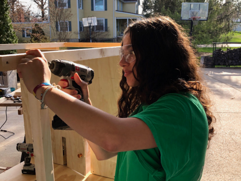 "Drilling into a wooden post, junior Sara Albarcha builds a hutch for her bunnies. From cutting the wood for the project to painting the hutch, Albarcha and her dad worked on the project together. ""I really enjoy getting to create things from my own vision, and most of all, I get to spend more time bonding with my dad, which wouldn't usually happen due to school and work,"" Albarcha said."