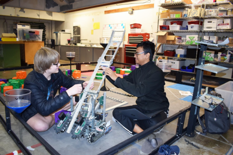 "During Robotics Club, sophomores David Meisinger and Rick Biswas build a robot that they competed with in local competitions. Freshman Joseph Britt notes that cooperation was an important factor in the team qualifying for worlds. ""Our team is mostly new people, so it is pretty exciting that we were able to work together,"" Britt said. ""I really like the environment there, and we have been spending a lot of our weekends working on the bot. We aren't fighting over jobs or fighting over who gets to do what or [over] what the bot should do. We are all able to work together and execute it as a team."""