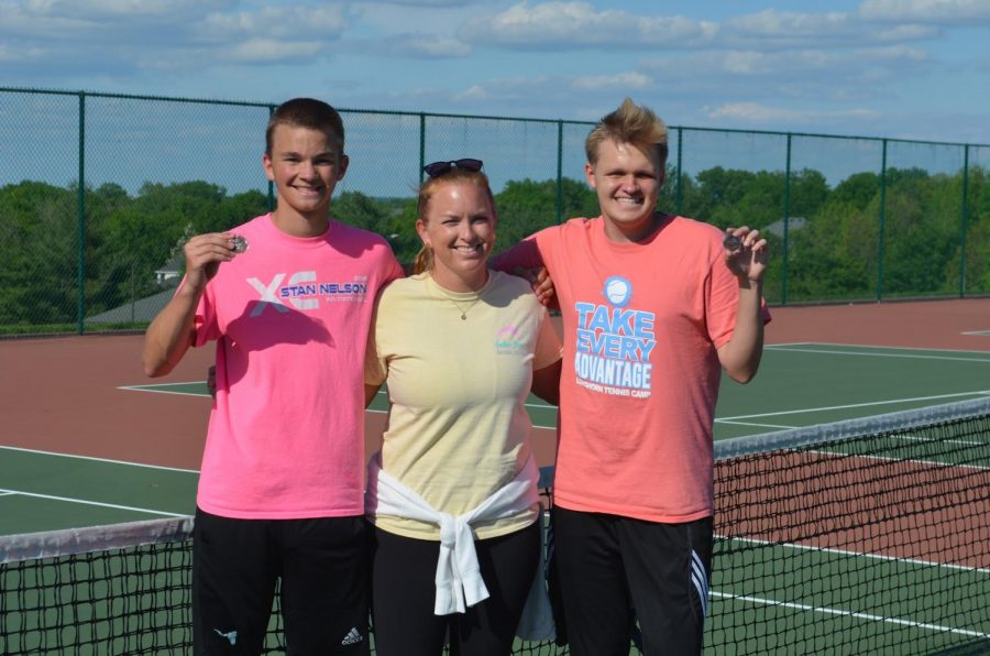Holding+their+third+place+medals+from+districts%2C+senior+Robert+McKnight+stands+alongside+his+teammate+Matt+Boyd+and+tennis+coach+Katelyn+Arenos+after+a+practice+during+their+junior+year.+They+spent+most+of+their+season+playing+doubles+matches+with+each+other.+%E2%80%9CPlaying+tennis+has+taught+me+a+lot.+Staying+committed+to+my+training+has+taught+me+discipline.+Struggling+through+back+injuries+has+taught+me+how+to+always+find+the+silver+lining.+Most+importantly%2C+my+tennis+career+has+taught+me+a+lot+about+humility+and+respect%2C%E2%80%9D+McKnight+said.+%E2%80%9CRespect+is+earned+in+many+ways.+It%E2%80%99s+about+correcting+your+mistakes+and+putting+others+first%2C+and+improving+the+lives+of+those+around+you%2C+because+you+%5Bcan%5D+personally+have+an+impact.%E2%80%9D