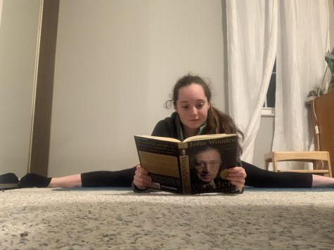 Multi-tasking to make the most of her time, sophomore and gymnast Paige Matthys-Pearce stretches and reads to learn about leadership.
