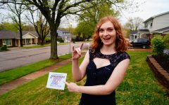 "Throwing her horns up, senior Maddie Hoffman has a ""Zoom prom"" with her friends. Hoffman and her friends dressed up to video chat on Zoom and celebrated prom together by coming up with funny senior superlatives. ""My favorite part was getting to spend that time with my sister. It's the sort of thing we normally would've been doing with friends, and we got to do it together. I think celebrating prom in a different way was just what everyone needed at a time like this,"" Hoffman said."