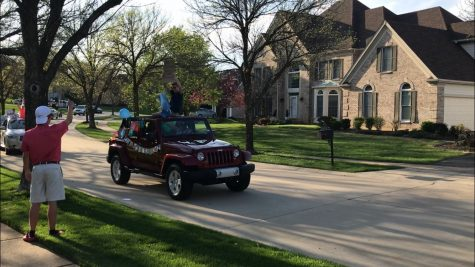 "Waving to friends and family, senior James Wachter celebrates his 18th birthday. The parade lasted seven minutes. ""After the parade, I texted each person thanking them for making my birthday one of the best,"" Wachter said."