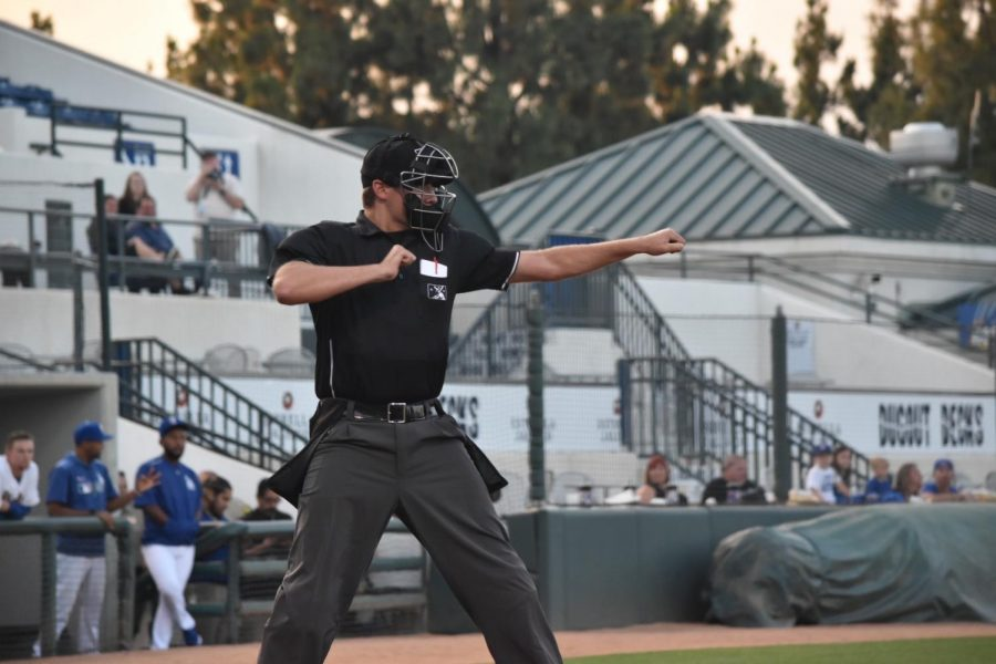 Putting+his+arms+up+to+strike+the+batter+out%2C+alumnus+Trevor+Dannegger+makes+the+call+behind+home+plate.+Dannegger+started+officiating+minor+league+baseball+games+in+2016%2C+along+with+being+a+substitute+teacher+in+his+time+off.+%E2%80%9CI+try+to+stand+out+in+both+roles%2C%E2%80%9D+Dannegger+said.+%E2%80%9CWhether+it+be+asking+a+teacher+to+continue+their+lesson+instead+of+showing+a+video+or+going+out+of+my+way+to+help+players+on+the+field.%E2%80%9D%0A