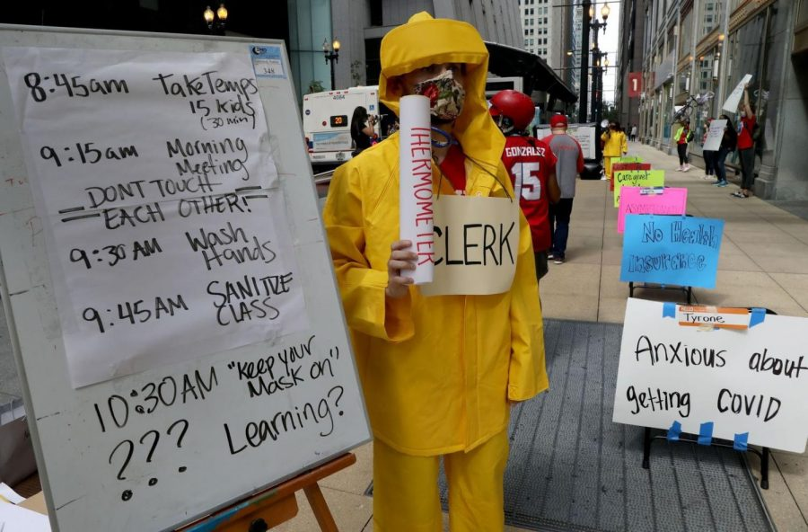 Teacher Andrew Van Herik protests outside Chicago Public Schools headquarters July 22.