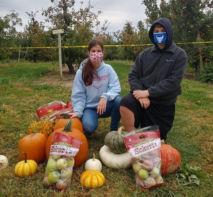 Picking apples with the family, freshman Presley George and her brother Henry George enjoy a day at Eckert's Farm. Going pumpkin picking is a great way to celebrate Halloween, and P. George and her family were able to have a safe, healthy day.