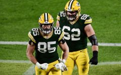 The Green Bay Packers' Robert Tonyan (85) celebrates with Lucas Patrick (62) after scoring a touchdown against the Atlanta Falcons at Lambeau Field in Green Bay, Wis. on Oct. 5.