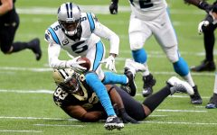Carolina Panthers quarterback Teddy Bridgewater (5) runs with the ball while being tackled by the New Orleans Saints' David Onyemata (93) in the first quarter at the Mercedes-Benz Superdome in New Orleans on Sunday, Oct. 25, 2020.