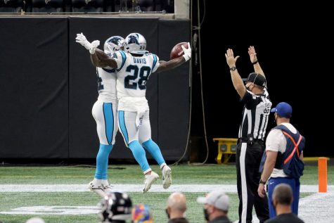 Carolina Panthers running back Mike Davis (28) celebrates his receiving touchdown with wide receiver Pharoh Cooper (14) in the second quarter against the Atlanta Falcons on Sunday, Oct. 11, at Mercedes-Benz Stadium in Atlanta, Georgia.