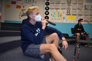 "Senior Braden Jensen sits on the stairs of his Jazz Choir classroom Nov. 19, his last day of in-person school for the semester. Jensen preferred in-person classes because it was easier for him to learn in a school setting, especially for choir. ""Singing through a mask is pretty interesting because you had less air to breathe in and the sound that came out could be kind of muffled,"" Jensen said. ""[But] with [choir] it was much better to sing with each other in-person."""
