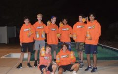 """Modeling their SunnyD hoodies and T-shirt, sophomores Ethan Deulca, Chris Roy, Basil Metroulas, Patrick Chen, Chris Woodcock, Shiv Sharma, Jake Rushing and Jack Maniaci advertise a beloved childhood beverage. """"[Sunny-D] is a very nostalgic drink for me. I remember going out to my fridge and getting a refreshing bottle of Sunny-D when I was little,"""" Rushing said."""