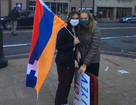 "Holding the Armenian flag and signs at a protest, juniors Mira Nalbandian and Anna Newberry work to bring awareness to the Armenia-Azerbaijan conflict. As an Armenian, Nalbandian feels that it is important for individuals to recognize and be aware of global issues. ""The American media hasn"