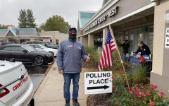"History teacher Zaven Nalbandian stands outside of a polling place at the St. Louis County Government Center. Nalbandian experienced socially distant lines, mask wearers and a comfortable and tolerant feeling in the air. ""I stood in the rain for the chance to once again exercise my right. I was feeling nostalgic as I thought back to that Tuesday in November in 1988 when I walked into the gym at Francis Howell North High School and punched the card,"