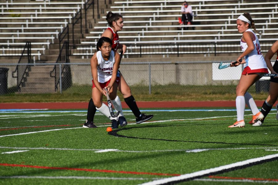 """Playing center midfield, junior Marissa Liu pushes the ball upfield. To stay focused, Liu worked on her skills and always found ways to improve. """"My favorite strategy was transferring the ball,"""" Liu said. """"I moved the ball to the other side of the field to open up space."""""""