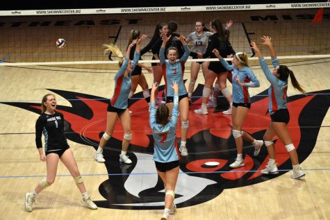 """The girls varsity volleyball team come together celebrating a block by senior Maddy Truka (2). The team finished with a record of 12-5 alongside a second place finish at the state tournament. """"It still feels surreal, but I couldn't think of a better way to have ended my senior season,"""" senior and team captain Carly Kuehl said. """"I think going into the season not thinking we would have a season makes it even better. At the beginning, we weren't really working for an end goal. As we kept moving on and kept winning, my excitement and desire to keep winning grew. I'm just so proud of my team and happy that this is how I got to end my volleyball career."""""""