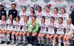 """Led by head coach Bob Kittner, sophomore Cate Adler (wing-back) and her team take the 2020 State Championship Cup. Numbering all of their appearances at State, Adler's team has a total of 19 wins, one tie, 79 goals for and three against. """"We've improved so much over the years. Corona definitely made us stronger and closer as a team,"""" Adler said."""