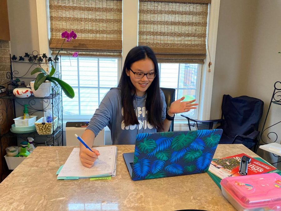 Smiling+at+her+zoom+screen%2C+junior+Tiffany+Ung+tutors+a+middle+school+student.+Ung+began+tutoring+this+week+and+hopes+to+make+a+difference+in+the+mindset+of+students+regarding+virtual+learning.+%E2%80%9CI+know+everyone%E2%80%99s+struggling+in+their+unique+situations+right+now%2C+so+I+figured+by+tutoring%2C+I+might+take+some+things+off+people%E2%80%99s+plates%2C%E2%80%9D+Ung+said.+%E2%80%9CI+want+kids+to+feel+confident+in+their+school+work+so+they+don%E2%80%99t+feel+bogged+down+by+everything+going+on.%E2%80%9D