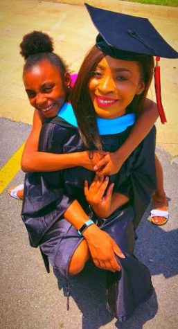 "With her daughter wrapped around her on graduation day, Smith celebrates receiving her master's degree from Arkansas State University. She received her degree in Educational Leadership in May of 2018.  ""It was a very proud moment. I felt accomplished and ready to move on to the next step in my career,"" Smith said."