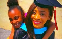 """With her daughter wrapped around her on graduation day, Smith celebrates receiving her master's degree from Arkansas State University. She received her degree in Educational Leadership in May of 2018.  """"It was a very proud moment. I felt accomplished and ready to move on to the next step in my career,"""" Smith said."""