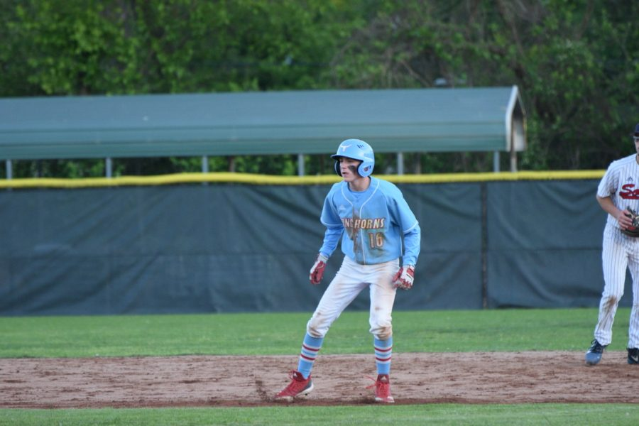 Preparing to run to the next base, senior Elliot Krewson watches the next pitch to the batter. Krewson has been playing baseball since he was 3 years old.
