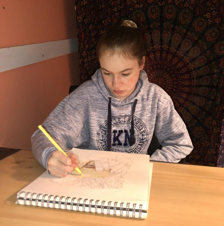 Coloring+a+portrait%2C+freshman+Rachel+Thomson+sits+at+her+desk.+Thomson%E2%80%99s+mother%2C+an+artist%2C+is+her+biggest+influence.+%E2%80%9CShe%E2%80%99s+encouraged+me+to+keep+going+from+the+beginning.+I+wasn%E2%80%99t+that+good+when+I+first+started%2C+but+I%E2%80%99m+lucky+she+encouraged+me+to+keep+at+it.+I+think+if+she+didn%E2%80%99t+support+me%2C+I+would+have+stopped+drawing+a+long+time+ago%2C%E2%80%9D+Thomson+said.