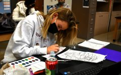 Picking up her paintbrush, senior Claire Hardy works on her next piece for AP Drawing. Hardy centered all of her projects on one sustained investigation question: