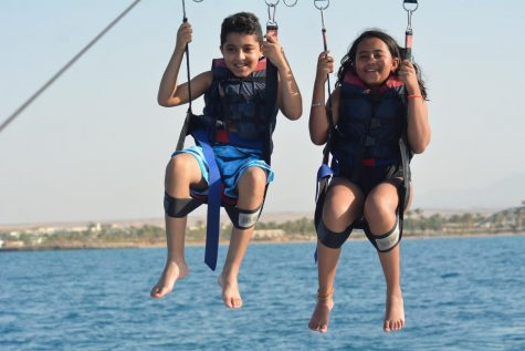 "On a trip to Hurghada, Egypt, freshman Alia Hammad and her cousin Omar parachute over the Red Sea. This adventure took place in July 2019, about four months before her big move. ""I loved it. I saw the purple jellyfish and coral [because] the water was so clear."" Hammad said."