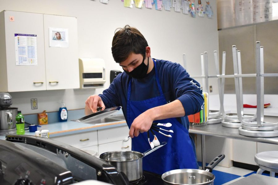 Adding+salt+to+the+water%2C+senior+Donald+Mahoney+carefully+measures+ingredients+to+cook+pasta+in+his+Let%E2%80%99s+Cook+Together+class+Feb.+23.+Mahoney+took+the+class+to+improve+his+cooking+skills%2C+and+so+far+the+biggest+challenge+has+been+making+sure+he+has+everything+he+needs.+%E2%80%9CMy+favorite+recipe+is+the+no-bake+cookies+we+made+once%2C%E2%80%9D+Mahoney+said.+%E2%80%9CI+just+love+all+of+our+cooking+days.%E2%80%9D