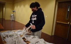 "Packing cookies in a bag, sophomore Lucy Connors volunteers to bag snacks for teachers at the United Hebrew Congregation. Volunteering is not new to Connors, as she also volunteered at a homeless shelter and served lunch. ""I enjoy helping the community and making a difference whenever I can,"" Connors said. ""I wanted to volunteer because I wanted to use my time doing something that betters someone else."""