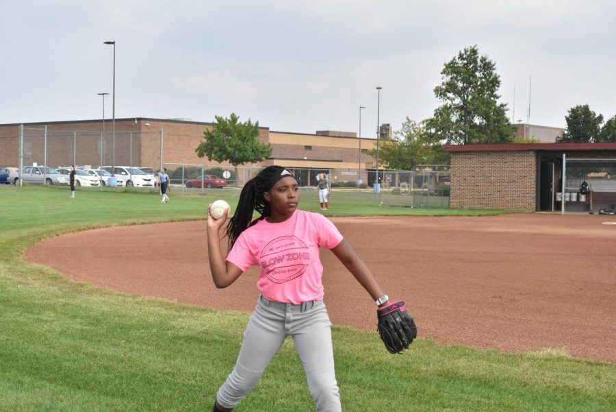 Freshman Tristen Banks pitches a ball at softball practice